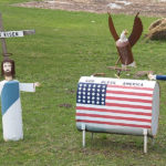 """""""'He Has Risen' & 'God Bless America' Lawn Ornaments, On Route 31 (Just North Of Beulah, MI)"""" by takomabibelot is licensed under CC BY 2.0"""